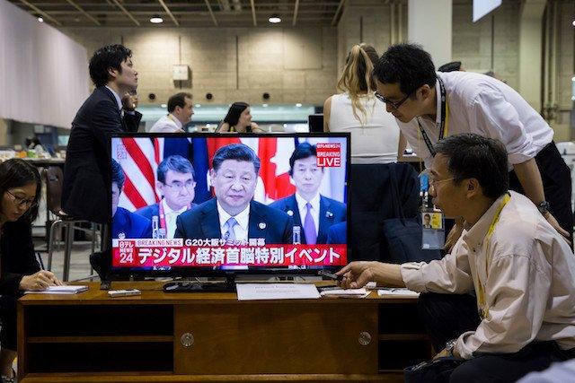 Phóng viên Trung Quốc ở Osaka